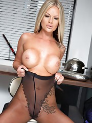 Porn babe Roxi in some sexy black pantyhose with a super cute ultra sheer heart section