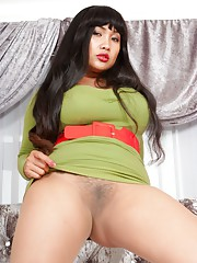 Asian MILF Amy and plays in the bedroom in some tan seamless pantyhose teasing in
