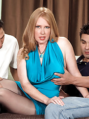 Horny tongue-flicking mom satisfies two young studs