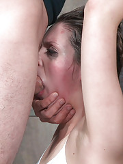 With her arms bound in custom metal shackles pulled up high on her knees Nora is