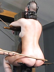 Master puts slave abigail back on the post for even more sadistic manipulation..
