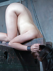 Milcah Halili is as wrapped up in chain bondage as they are wrapped around O.T.s