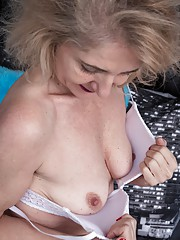 Isabella Diana is relaxing in her bedroom in her blue shirt and stockings. She strips