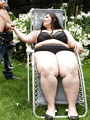 Naughty brunette BBW Jitka sitting on a guys face outdoors