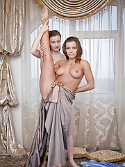 Aruna A and Emily Bloom sensually poses indoors baring their sweet pussies.