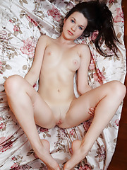 Serena Wood displays her delectable body on the bed.