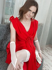Pique Dame is 41 and enjoying putting on makeup in her red dress. She strips naked