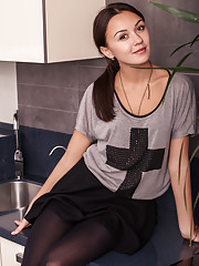 Veselin strips in the kitchen baring her petite tanned body.