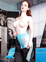 Sexy redhead Zara is in some stunning turquoise designer hose with a see through