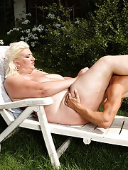 Naughty blonde BBW Monika sitting on a studs face outdoors