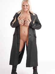 Busty blonde babe Charley is looking stunning wearing nothing but a long leather