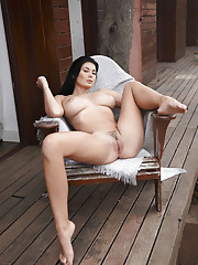 Lucy Li erotically poses on the veranda baring her curvy body with meaty ass and