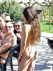 Surrounded by 8 soccer beer and barbecue focused oldje the innocent Anita Berlusconi