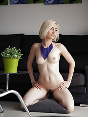 Gorgeous Janelle B bares her creamy white body with trimmed pussy as she poses on