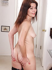 Brunette housewife Bridget Calling spreads her hairy pussy.