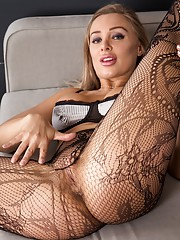 Busty cougar Beth Bennett naked in black stockings.