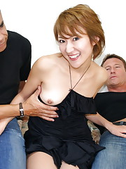 This hot girl is sandwiched between two horny dudes and she loves it