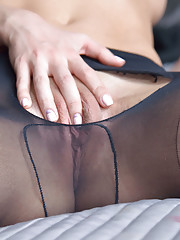 Horny Olia rips her nylons for better access to her honeypot