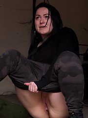 Chubby babe squats to piss in an outbuilding
