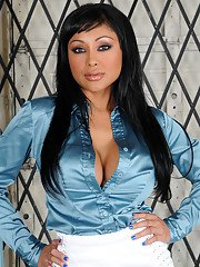 Exotic Priya Rai strips out of her work clothes to show off her curves