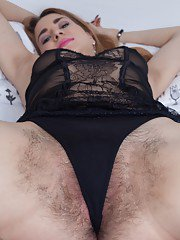 Nara Abel has awakened from bed and is horny. Wearing her black lingerie we can see