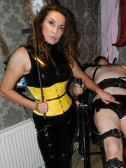 Strapon Jane rounds up her slaves in the dungeon for some deep throat action on her