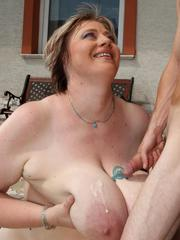 Big titted blonde BBW milf sitting on a guys face outdoors