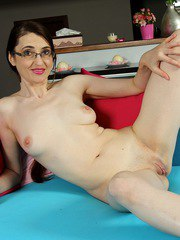Brunette housewife Liz Fernandez naked on the couch.