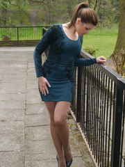 Hot babe Naomi is outdoors in a short tight dress showing off her sexy long nylon