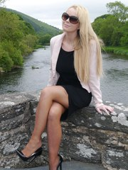 Gorgeous blonde Larissa poses by the river in a sexy black dress and matching high
