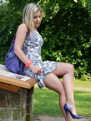 Blonde goddess Naomi is catching a rare bit of sunshine and flashing her cheeky long
