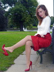 Hot red head Sophia steps out the office on her lunch break to parade around the