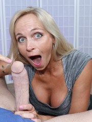 Horny mature lady Dani Dare strokes monster-sized prick with both hands asking for