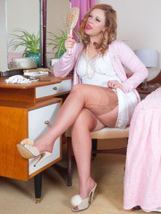 Anna dressed in retro finery and knows her G spot is ready for pulsating orgasm.