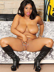 Ebony plumper gets naked and fuck her pussy with sex toys