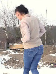 Pretty babe squats in the snow and pisses outside