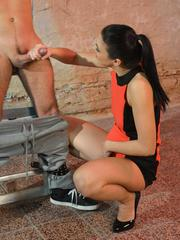 Tied up male slave gets a forced handjob from a hottie girl