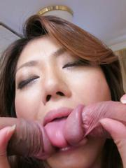 Reina Nishio Asian sucks two dicks and gets two fingers in pussy
