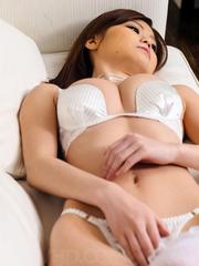Nao Asian in white lingerie rubs her clit and uses dildo in twat