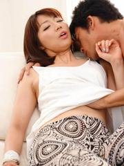 Izumi Manaka Asian sucks dick and is fingered before drilling