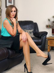 Girl next door Debbie puts on a sexy home tease just for you wearing her silky nylons