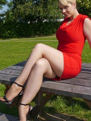 Hot blonde Milf Larissa wants you to join her and her beautiful long shiny legs for