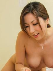 Mirei Yokoyama undresses and takes cock in footjob and blowjob