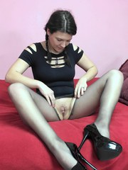 Brianna Stars in torn pantyhose and fucking her toy