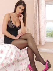 Gorgeous leggy babe Sofia is in her bedroom in some sexy lingerie and nylons and