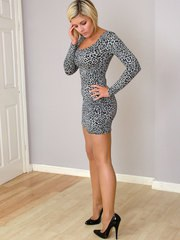 Stunning babe Naomi is dressed up in a very short dress flashing her sexy legs and