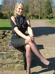 Gorgeous blonde Demi catches some sun out and about wearing a pretty black blouse