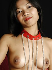 Smiling escort girl from Bangkok takes off her trendy lingerie to show her tight