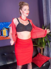 Holly dressed in black full fashion nylons matching heels and dressed in racy red