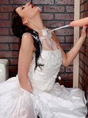 Sexy brunette bride takes a massive cumload on the gloryhole